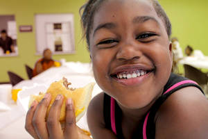 Beautiful smiling girl with sandwich